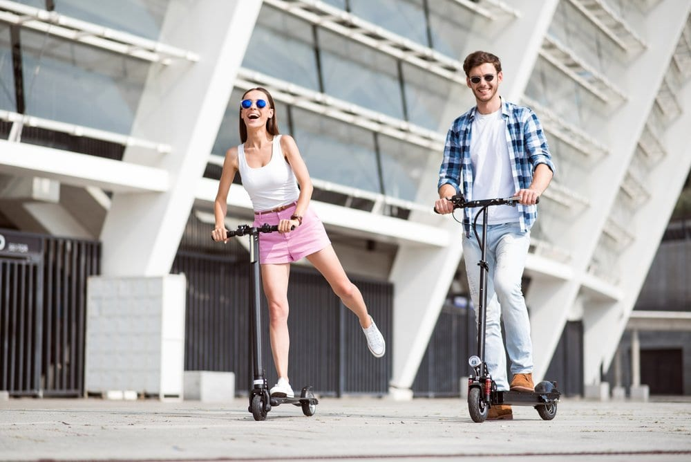 riding a kick scooter